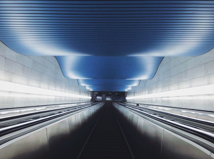 Empty illuminated escalator