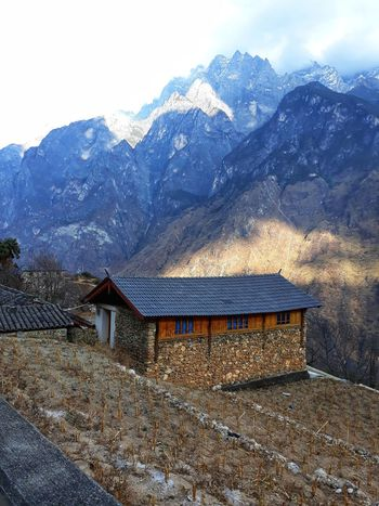A mountain hut Blue Sky Jade Snow Mointain Haba Mountain Tiger Leaping George Lijiang Yunnan ,China China Yangtze River Scenics - Nature Scenery Rock Mountain Travel Hike Hiker Mountain Roof Sky Architecture Building Exterior Built Structure Snowcapped Mountain Country House Rocky Mountains Tranquil Scene Snowcapped Scenics Non-urban Scene Countryside