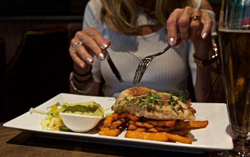 Lunch in Stockholm Sweden Chicken Sweet Potato Fries Beer Glass Bowl Close-up Day Food Food And Drink Fork Freshness Guacamole Healthy Eating Holding Human Body Part Human Hand Indoors  Midsection One Person People Plate Ready-to-eat Real People Table