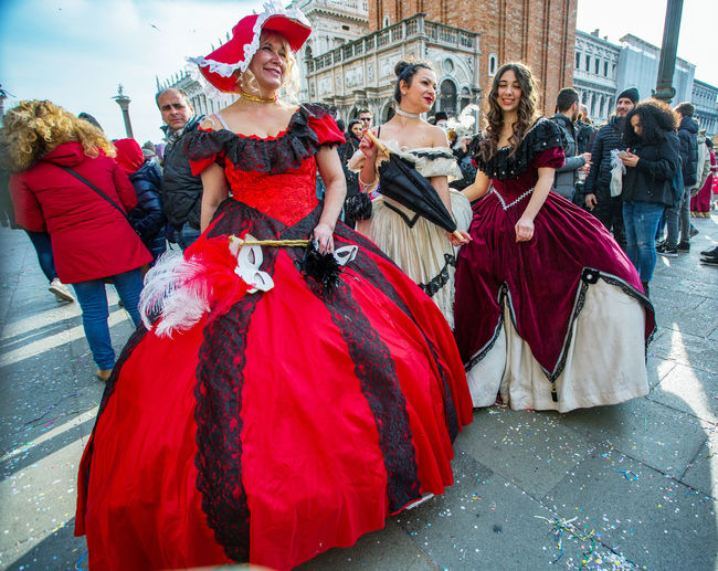Carnival Carnival In Venice Adult Adults Only Architecture Arts Culture And Entertainment Building Exterior Built Structure Carnival Costumes City Cultures Day Large Group Of People Mask Men Outdoors People Performance Real People Red Togetherness Tradition Women