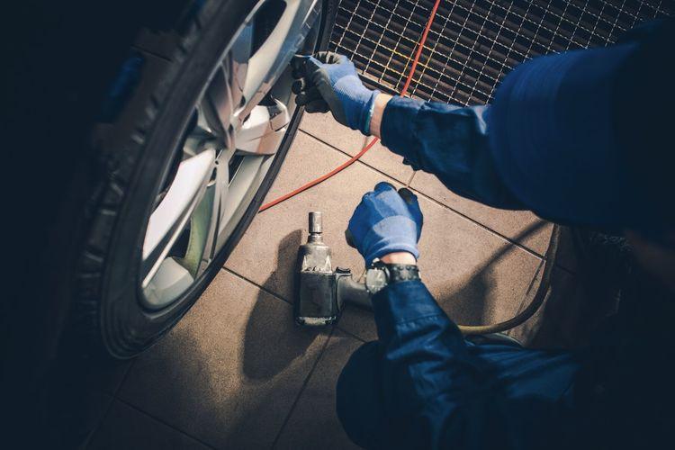 Low section of mechanic repairing car