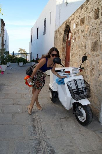 Lindos Architecture Beauty In Nature City Full Length Greece Land Vehicle Lifestyles Looking To The Mirror Mirror Mode Of Transport Motorbike Motorcycle One Person Outdoors Standing Transportation Women Young Adult Young Women Honda Delivery Delivery Service Beauty Done That.