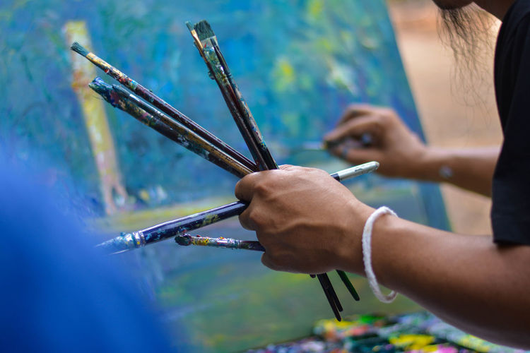 Art Painting 01 Adult Art And Craft Artist Brush Craft Creativity Focus On Foreground Hand Holding Human Body Part Human Hand Leisure Activity Midsection Occupation One Person Paintbrush Real People Selective Focus Skill
