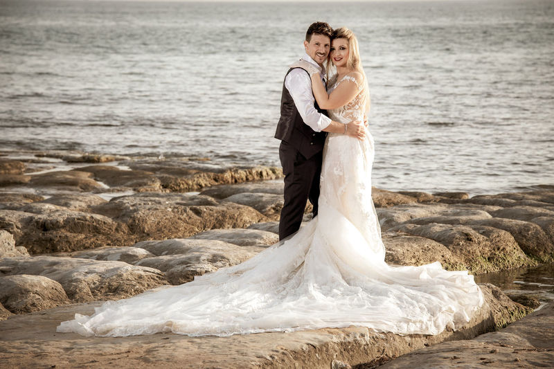 Adult Bride Bridegroom Celebration Couple - Relationship Emotion Event Full Length Heterosexual Couple Husband Love Married Men Newlywed Outdoors Positive Emotion Sea Two People Water Wedding Wedding Dress Wife Women Young Adult