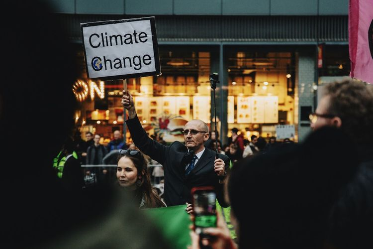 Environmentalchange Environmental Change Global Warming Politics Protest Demo Extinction Rebellion Climate Change Demonstration Communication Group Of People Text Real People Architecture Illuminated City People Sign Holding Street The Art Of Street Photography The Street Photographer - 2019 EyeEm Awards