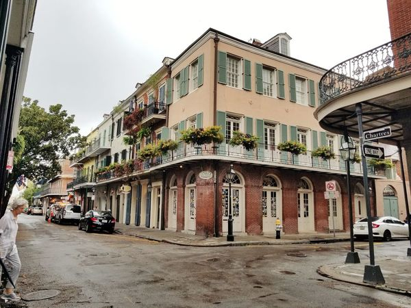 beauty in every corner French Quarter History Balcony French Quarter  Nawlins Flowers Arches Gaslamp New Orleans Townhouse Old Town People In The Background Place Of Interest Pavement Town Square Window Box Vehicle Street Art Awning Residential Structure Land Vehicle Car