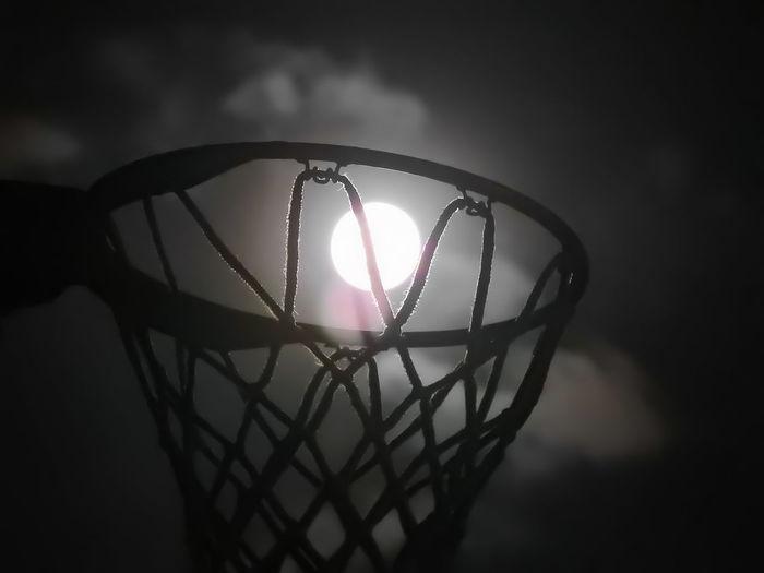 Close-up of illuminated lamp against sky