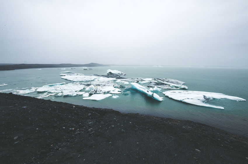 Days of travel: 7 - Jökulsárlón glacial lagoon Iceland Travel Beauty In Nature Cold Cold Temperature Day Environment Floating On Water Frozen Glacier Horizon Over Water Ice Lagoon Land Nature No People Outdoors Scenics - Nature Sea Sky Snow Tranquil Scene Tranquility Water Winter