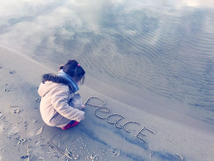 Peace Full Length High Angle View Sitting Childhood One Person Peace Peace And Quiet Drawing Peace ✌ Peaceful Beach Exceptional Photographs EyeEm Best Shots EyeEm Masterclass Minimalistic Sand Silhouette Stick