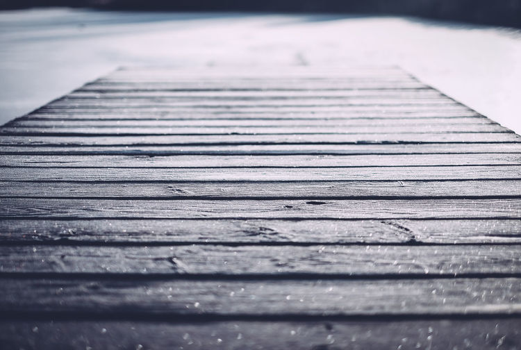 Close-up of boardwalk during winter