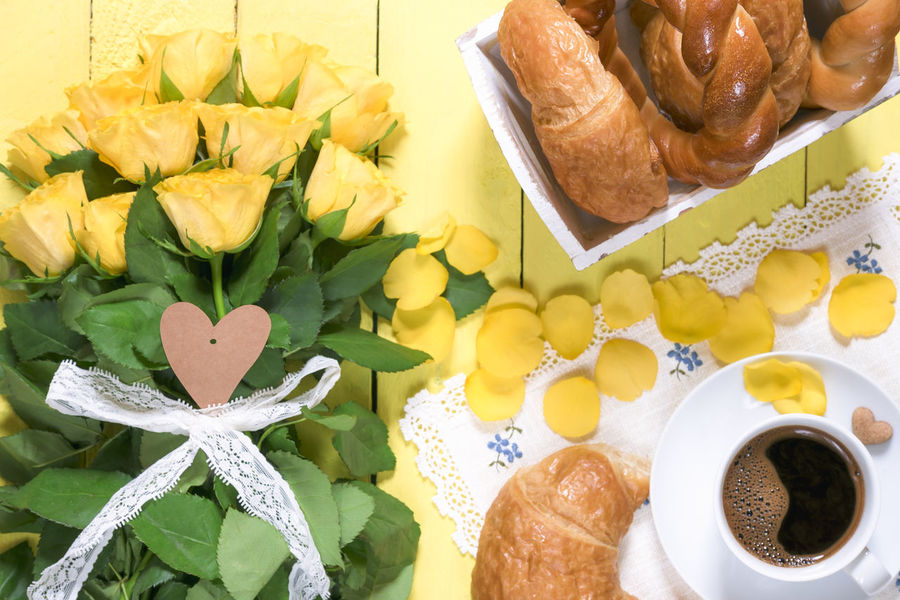Morning meal with pastry products, a cup of aromatic coffee and a big bouquet of yellow roses and petals, placed on a yellow wooden table. Breakfast Morning Coffee Mother's Day Romantic Valentine's Day  Bouquet Bouquet Of Flowers Croissant Flower Flowers Flowers Bouquet Food Food And Drink Hot Coffee Morning Meal Still Life Table Warm Coffee Yellow