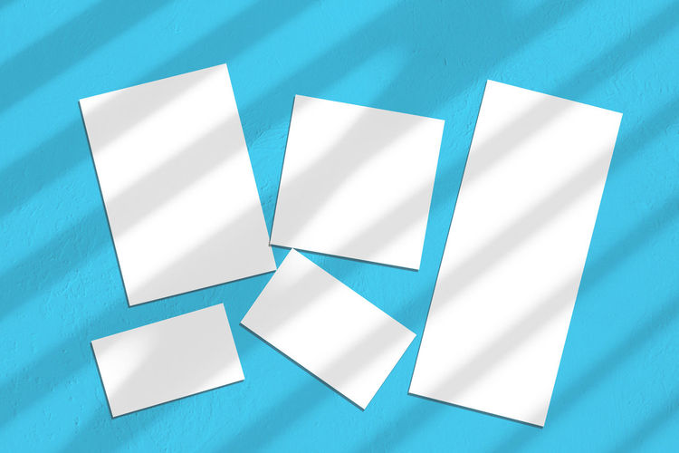 High angle view of paper on blue table
