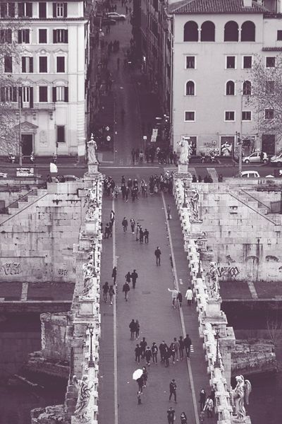 Roman streets Building Exterior Architecture Built Structure Reflection Water City Real People Outdoors Large Group Of People Day People Bridge Rome Italy Monochrome Soft Best EyeEm Shot Backgrounds Monochrome Photography Tranquil Scene Urban Cityview Streetphoto Architecture Cityscenes