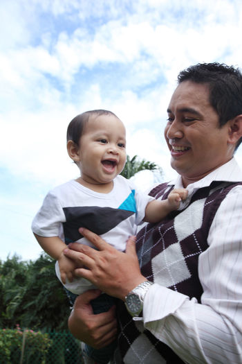 family father with child in the park Asian  Baby Domestic Life Fondness Grow Up Joyful Love Relationship Blue Sky Bonding Boy Carry Childhood Embracing Enjoy Family Time Father Father And Son Free Time Photography Garden Kid Leisure Activity Malay Ethnicity Park - Man Made Space Toddler