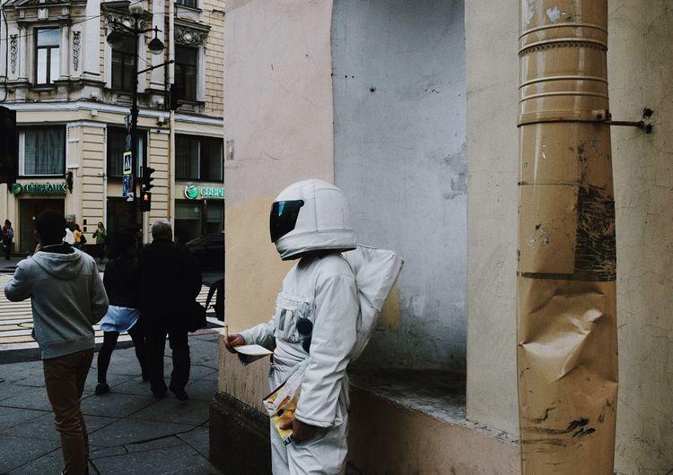 Rear view of men standing in city
