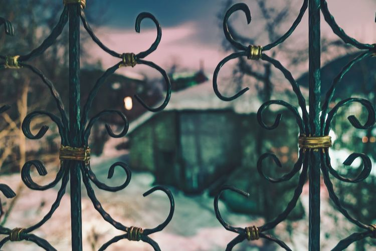 Close-up of metallic ornate gate