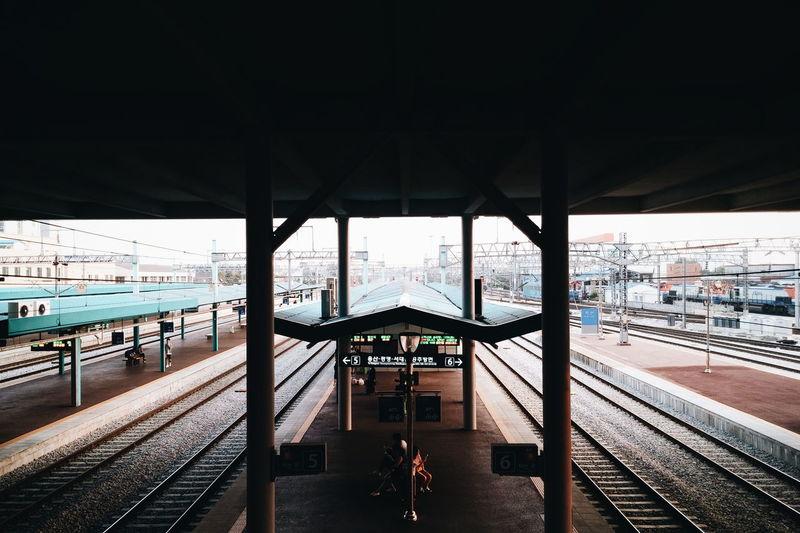 Railroad station platform under bridge at station