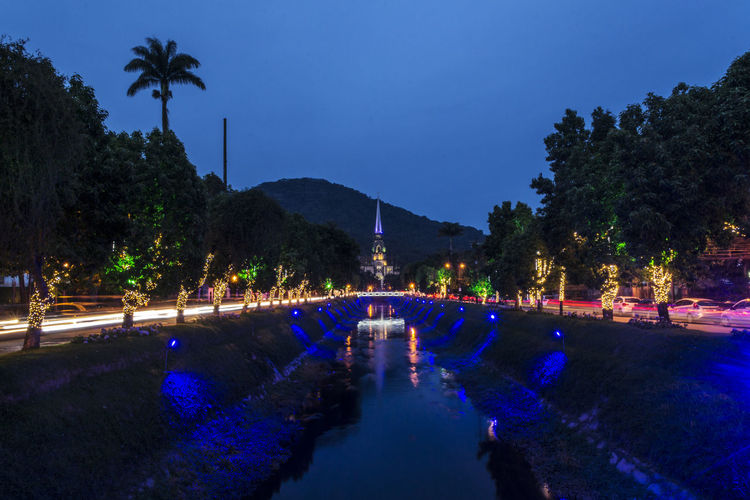 Brazilian street decorated with Christmas lights Tree Plant Illuminated Night Sky Nature Architecture Blue Water Tropical Climate Building Exterior Dusk Palm Tree No People Built Structure Reflection Clear Sky Outdoors City Treelined Christmas Lights Urban Photography Christmas Decoration EyeEmNewHere Holiday Moments Capture Tomorrow