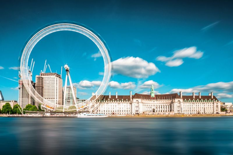 Long exposure captures movement of the London Eye England United Kingdom Silky Water Landmark Sunny Day Motion Blur Longexposure Sightseeing Capital City London Southbank LondonEye EyeEm Selects Architecture Built Structure Sky Building Exterior Water City Cloud - Sky Travel Destinations Waterfront Travel River