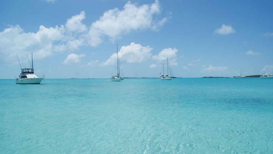 Sea Turquoise Colored Scenics Beach Cloud - Sky Nautical Vessel Blue Tranquility Idyllic Sand Sky Outdoors Transportation Day Travel Destinations Nature Vacations Travel Horizon Over Water Tranquil Scene Boats Sailing Boats Bahamas Turquoise Water Summer