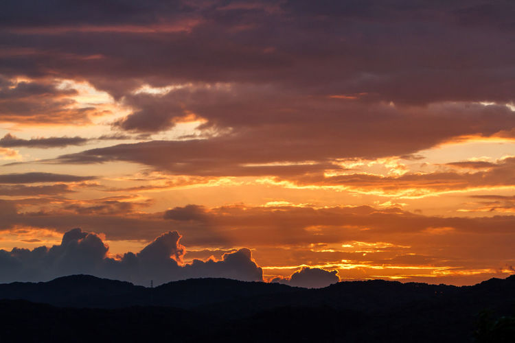 Idyllic Shot Of Silhouette Mountains Against Orange Cloudy Sky During Sunset