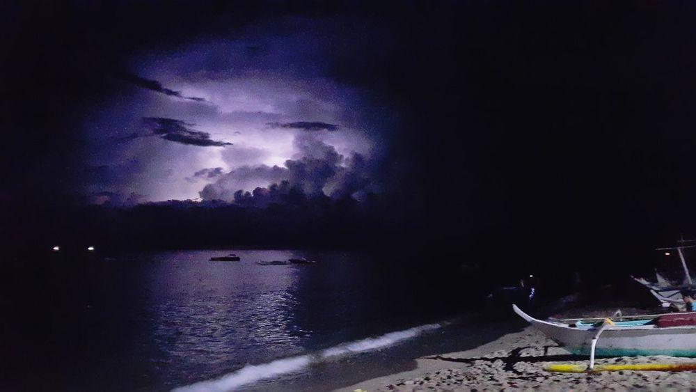 Calm seas might be hiding a storm beneath a veneer of clouds Beachphotography Beach Nightphotography Phone Photography Phonetography SM-N910C Water Astronomy Lightning Sky EyeEmNewHere