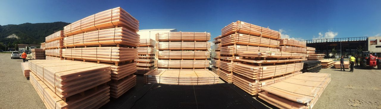 Stack of palettes against clear blue sky