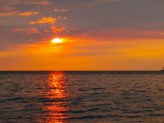 Sunset view at Port Dickson beach Negeri Sembilan Malaysia Water Wave Sea Beauty Horizon Sunset Beach Multi Colored Sailing Summer Tide Refraction Spectrum Low Tide Seascape Coastline Coastal Feature Coast Surf Romantic Sky Moody Sky Atmospheric Mood Cumulus Cloud Sky Only Forked Lightning