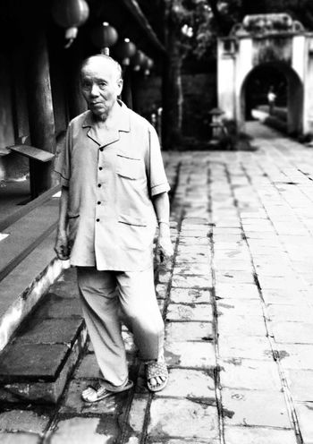 The way he frowns, the way he staggers, the 'clothes' he wore, the sandals he had. There was something about this old guy. A story untold. Peoplephotography People Watching Fortheloveofblackandwhite
