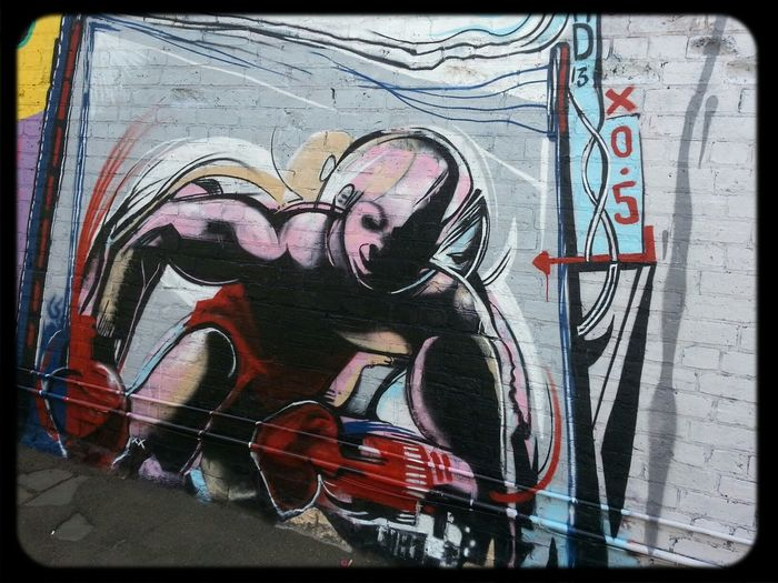 Streetart by RAD conrad bizjak. Boxer with red gloves. Graffuturism