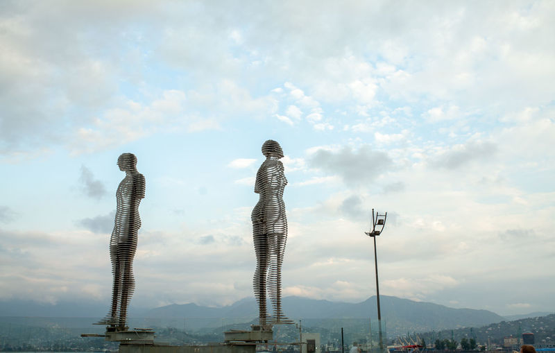 Two lowers statue Batumi Georgia Cloud - Sky Sky Architecture Nature Built Structure People Standing City Building Exterior Women Real People Outdoors Lifestyles Young Adult Day Emotion Leisure Activity Two People Adult Full Length Cityscape Landscape Batumi Georgia Evening Monument