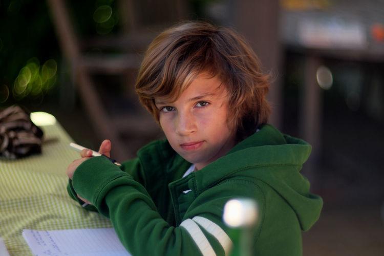 Portrait Of Boy Doing Homework