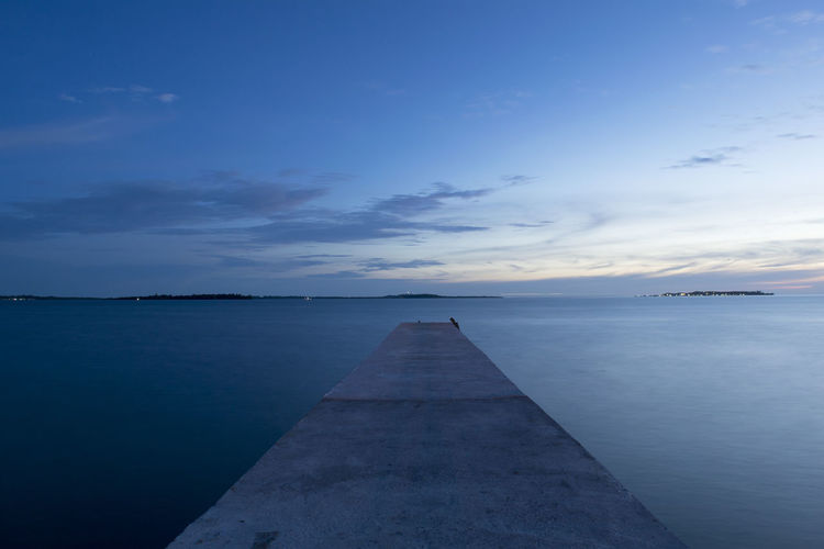 Sea Water Sky Landscape Blue Beach Horizon Over Water Tranquility Scenics Beauty In Nature Cloud - Sky No People Outdoors Tranquil Scene Nautical Vessel Night Sunset Discovery Nature Sunset_collection Middle Mid Symmetry Long Exposure Bridge Perspectives On Nature Rethink Things