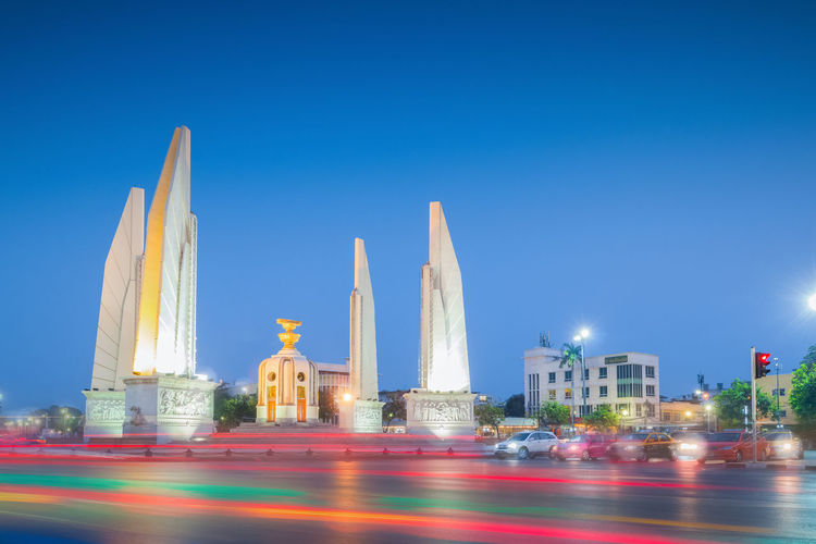 Illuminated buildings against blue sky