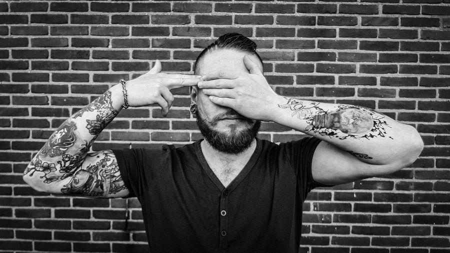 Tattoed #tattoo #tattooed #INK #inked #man Front View Brick Wall Headshot Tangled Hair Hairy  Eyes Closed  Napping Body Adornment Hands Covering Eyes This Is My Skin
