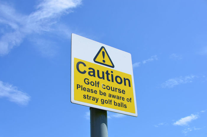 Caution Caution Sign Caution ⚠️ Golf Golf Course Warning Signs  Blue Communication Low Angle View No People Road Sign Sky Warning Warning Sign Warning! Yellow