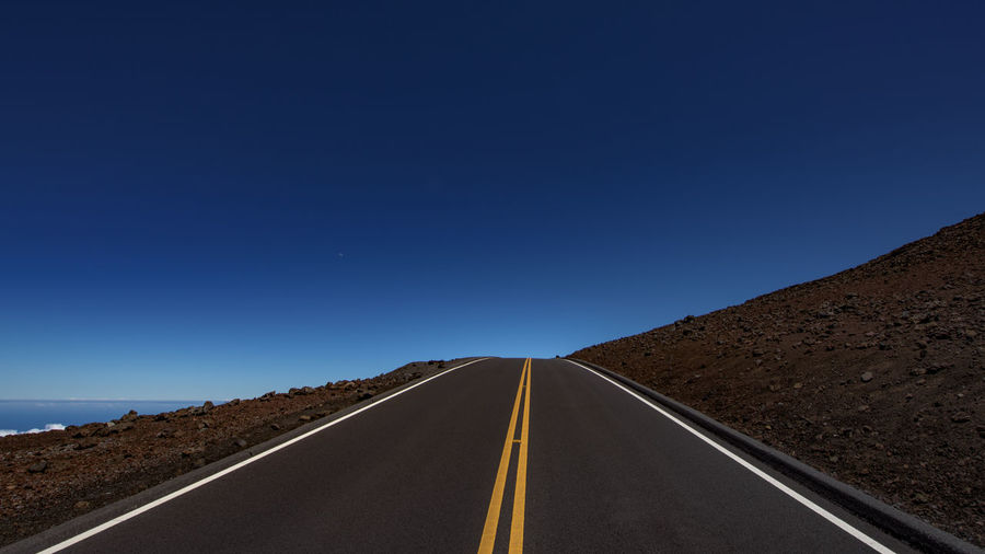 Driving up to the summit of the volcano Above Arid Climate Asphalt Clear Sky Day Dry Haleakala Haleakala National Park Hawaii High Landscape Maui Nature No People Outdoors Road Sky The Way Forward View Volcano Fresh on Market 2016 Finding New Frontiers