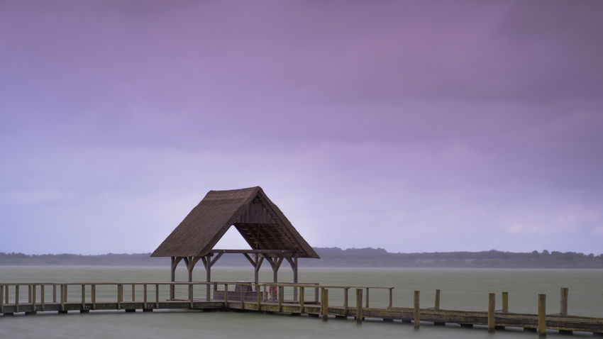 Storm house Fresh On Eyeem  Hemmelsdorfer See Schleswig-Holstein The Week On EyeEm Architecture Beauty In Nature Built Structure Day Jetty Landscape Lonely House Nature No People Outdoors Pier Reed Scenics Sea Sky Stilt Stilt House Tranquil Scene Tranquility Water Betterlandscapes An Eye For Travel