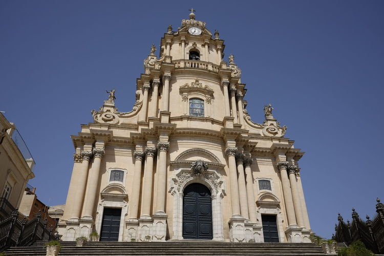 Architecture Baroque Style Blue Building Exterior Built Structure Cathedral Clear Sky Day Duomo History Ibla Low Angle View No People Outdoors Place Of Worship Religion Sculpture Sky Spirituality Statue Travel Destinations