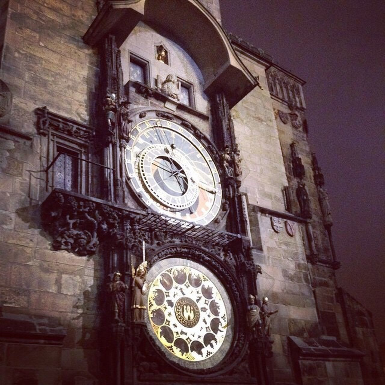 religion, place of worship, spirituality, building exterior, architecture, low angle view, travel destinations, clock, built structure, history, rose window, clock tower, ornate, astronomical clock, day, no people, outdoors, statue, bell tower, time, sculpture, roman numeral, sky, clock face