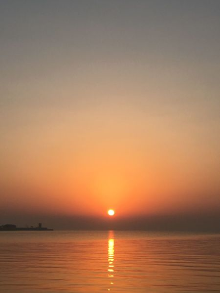 Beauty In Nature Clear Sky Day Horizon Over Water Idyllic Nature No People Orange Color Outdoors Reflection Scenics Sea Sky Sun Sunset Tranquil Scene Tranquility Travel Destinations Water Waterfront