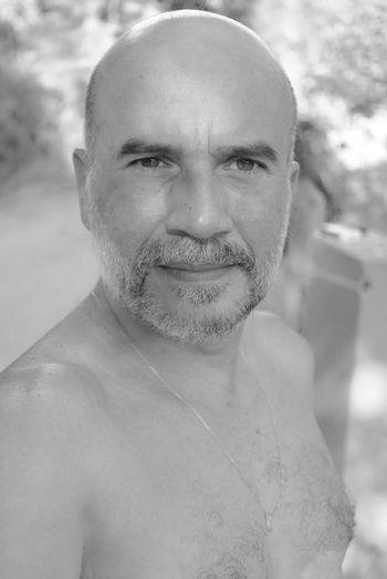 Close-up portrait of shirtless man