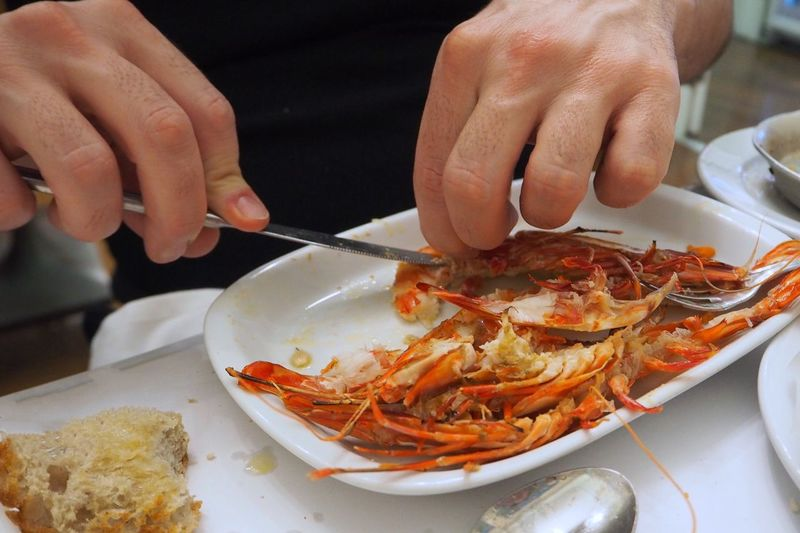 Eating With Fingers Prawns Eating Food And Drink Human Hand Food Human Body Part Freshness Real People One Person Seafood Plate