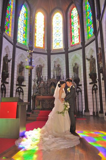 Architecture Belief Bride Building Built Structure Celebration Event Full Length Indoors  Life Events Newlywed Place Of Worship Positive Emotion Real People Religion Spirituality Stained Glass Wedding Wedding Ceremony Window Women