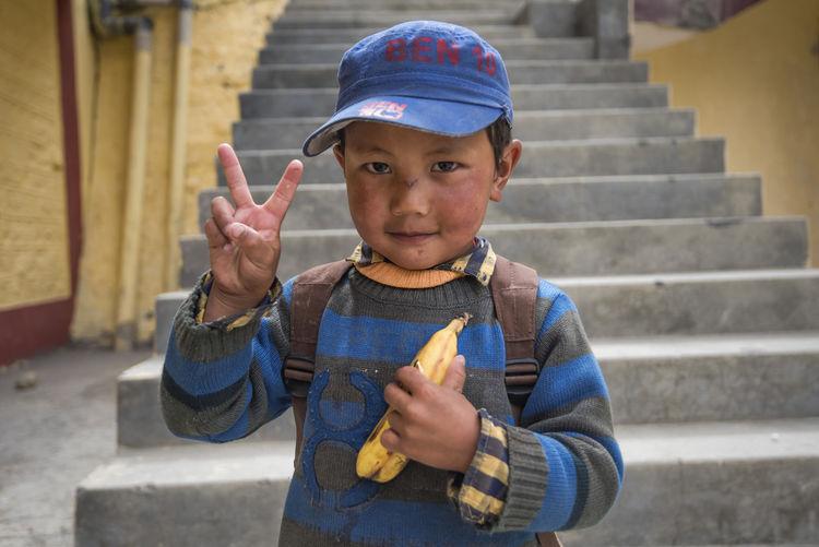 Portrait of boy on steps