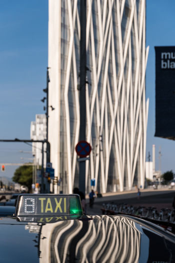 Barcelona, Spain - September 24, 2017: The skyscraper Diagonal Zero Zero and the Blue Museum of Natural Sciences (Museu Blau) are being reflected in the metal roof of a taxi. Both buildings are important architectural landmarks in Barcelona. Diagonal Zero EyeEmNewHere Taxi Architecture Building Building Exterior Built Structure Car City Day Diagonal Zero Zero Focus On Foreground Land Vehicle Mode Of Transportation Nature Office Building Exterior Outdoors Sign Sky Skyscraper Sunlight Transportation Travel