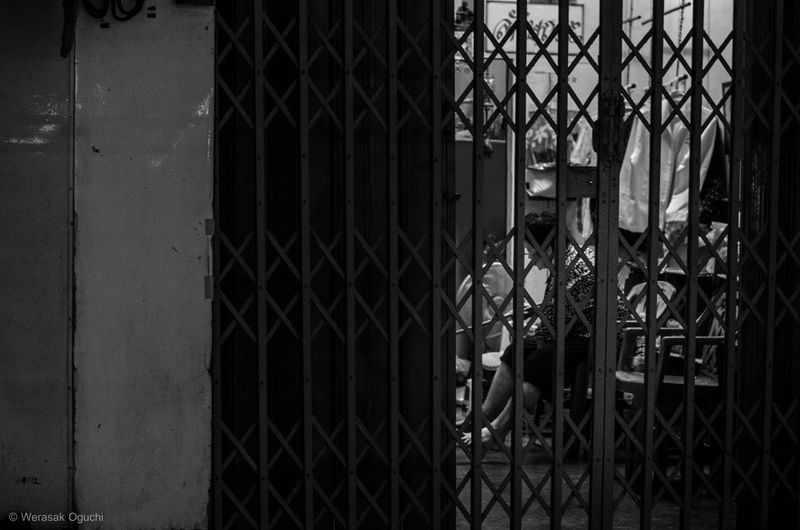 Safe zone. . 1/80sec. f./2.8 iso1600 focal length 50mm Blackandwhite Classic Street Door Gate Monochrome Old Town People Real People Safety Security The Street Photographer - 2017 EyeEm Awards