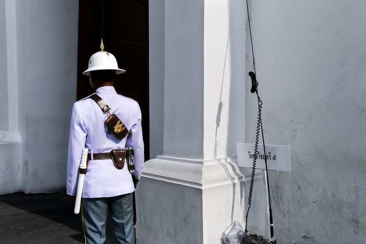 Outside the Grand Palace, Bangkok, Thailand Adults Only Bangkok Contrast Grand Palace Grand Palace Bangkok Thailand Guard Guardian Guarding Hardhat  Headwear One Man Only Outdoors Rear View Royalguard Royalty Shadows Siam South East Asia Street Photography Streetphoto Streetphotography Thailand Uniform UNPOSED The Street Photographer - 2017 EyeEm Awards