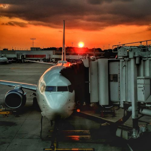 Into the Night - Plane parked during sunset at Atlanta's international airport. Sunset Sky No People Outdoors Plane Airport Airportphotography Airport Runway Airport Clouds Atlanta Atlantaphotog AtlantaNights Cloud - Sky