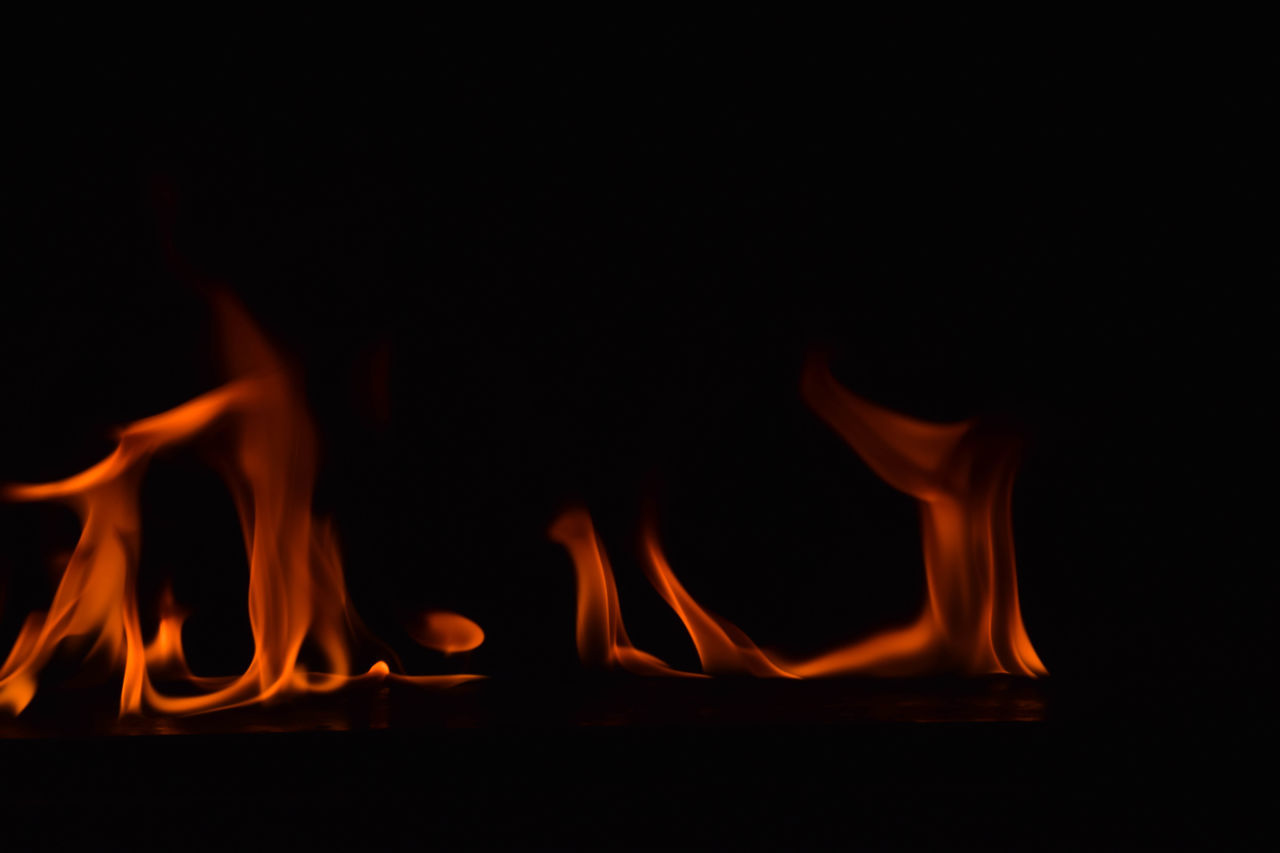 burning, fire - natural phenomenon, flame, heat - temperature, glowing, night, close-up, bonfire, no people, black background, indoors